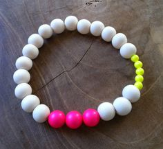 Beaded bracelet in white, neon pink and neon yellow