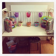 Crib repurposed into a desk. She loves it! Set to highest setting, place down white hardboard, add cute dollar store storage & a stool or chair! You could also add cork or chalkboard paint. Cute Desk Chair, Old Cribs, Toy Organization, Organizing, Tapas, Cot Bedding, Toy Rooms, Chalkboard Paint, Recycled Furniture