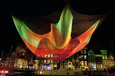 "A light sculpture titled ""1.26"" by Janet Echelman of the U.S. hangs over Amstel river during the opening of Amsterdam Light Festival in Amsterdam December 7, 2012. Description from pinterest.com. I searched for this on bing.com/images"
