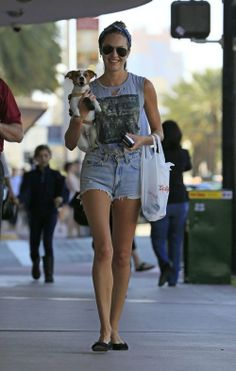 With her furry friend by her side, Candice Swanepoel headed to Walgreens in South Beach, Florida. The Victoria's Secret Angel sported a ripped Iron Maiden T-shirt, perfectly destructed Levi's vintage daisy dukes, and black flats as she carried her...