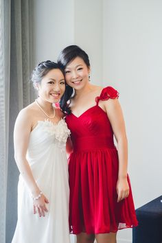What red and white and fabulous all over??? This bride and her maid dressed in red! So chic and modern!  #brideside #realwedding #bridesmaid #maid #bride red  A colorful wedding from Australia | Brideside