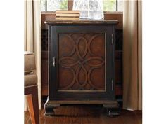This upscale accent chest is crafted from hardwood solids and ash burl veneers.