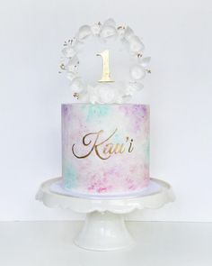 Had a total cake crush when I finished this baby.. Realised I was stealing glances at it every time I walked past and grinning like a loon Thanks so much to my client Kema for entrusting me to design her daughter's first birthday cake. This one was finished with a watercolour effect gold name/topper and adorned with a delicate wafer paper wreath halo. @sugarsugar_cakes #sugarsugarcakes #waferpaperflowers #adelaidecakes #adelaide #birthdaycake #cakelove #cakestagram #instacake #acdnmember…