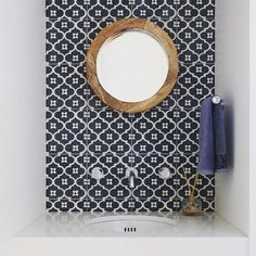 navy patterned tile, round oak mirror