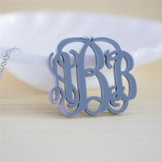 Acrylic monogram necklace - would want in turquoise or white. $28.95
