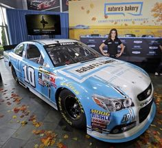 Danica Patrick, driver of the #10 Stewart-Haas Racing Chevrolet, poses for a photo opportunity after she announced a multiyear deal partnership with Nature's Bakery during a press conference on August 18, 2015 in Kannapolis, North Carolina. The partnershi
