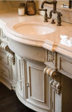 love the corbels and carved elements and of course the marble counter top