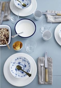 Nordic table setting in blue tones featuring tableware from Royal Copenhagen.