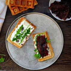 Waffle sandwiches topped with a creamy spicy sweet spread, arugula and COFFEE BACON.