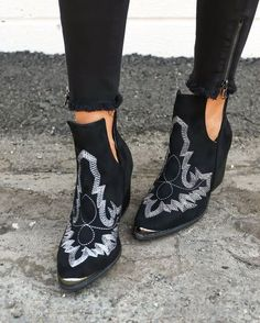 Break rules in our black Laweson Boot! These vegan suede ankle boots have a metal tipped toe with a wooden, block heel and side cutouts that make it easy to pull on! The white embroidery on the front Cute Shoes, Me Too Shoes, Pretty Shoes, Mode Country, Fall Wedges, Over Boots, Luxury Shoes, Crazy Shoes, Wedge Shoes
