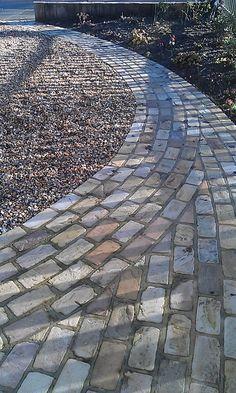 Front garden path bordering gravel drive #paths #gardens http://www.johnwoodgardendesign.co.uk/