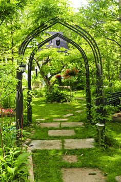 A wrought iron trellis arching above your pathway is an elegant, yet simple statement. Iron trellises are better for shady, cool areas, because they can heat up quickly in the sun and stunt the growth of your vines.