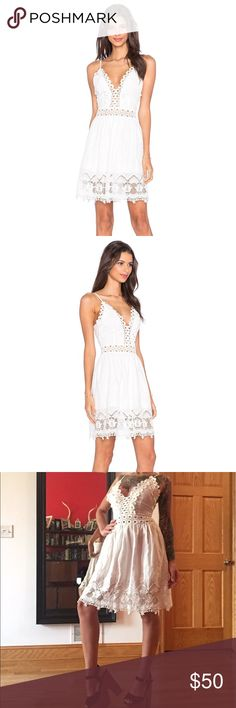 "Tony Heart Ginger Summer white crochet dress Purchased from revolve for $150. Perfect for summer, vacations, beach hangs & resorts. Hyper feminine strappy backless dress with cute crochet detailing along plunging neckline. I have not worn it as its a little small for my bust. I am 5""3 35-25-34 100% cotton, Hand wash cold Neckline to hem measures approx 31"" in length Fully lined Adjustable shoulder straps Crochet lace accent Hidden back zipper closure Revolve Style No. TOBR-WD39 toby heart…"