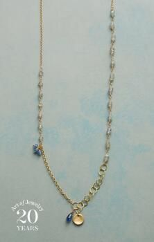 Lovely elements create a captivating whole in this sapphire and labradorite charm necklace by Anne Sportun