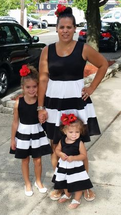 This family is so cute in a classic black/white/red combo! Love it! Mommy and me matching from Be Inspired Boutique