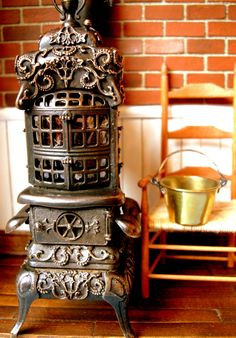 antique cast iron wood stove is a piece of art.