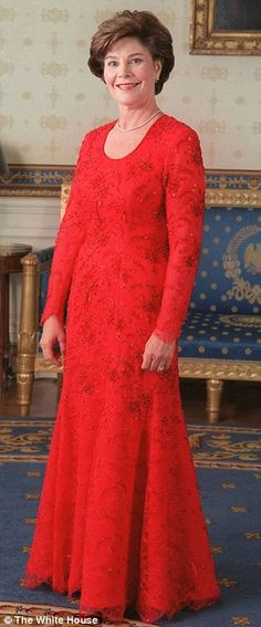 Laura Bush wore a red gown of crystal-embroidered Chantilly lace over silk georgette to the 2001 inaugural balls. The dress was designed by fellow Texan Michael Faircloth