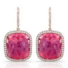 Rahaminov's incredible pink sapphire earrings stand out in their 18k rose gold settings.