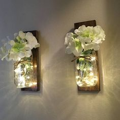 Set of 2 rustic mason jar lanterns bring a rustic look to any room. Place them you your entryway, bathroom, living or kitchen for a new look. These these hanging lanterns are made with pallet wood stained with your choice of walnut or antique white. Hook has been added to let the mason