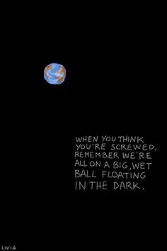 a big, wet ball floating in the dark