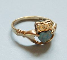 10K Yellow Gold and Opal Claddagh Ring. For more: http://www.bestuniqueengagementrings.com/diamond-engagement-ring-alternatives.html/10k-yellow-gold-and-opal-claddagh-ring