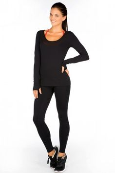 Sophia Excel Long Sleeve Top. It comes in Black, has mesh on the collar and the backside, and has thumbholes. Lots of sizes left at the store!