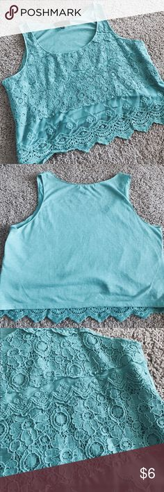 Cute loose teal crop top! Fits true to size! 👗Super cute top for the spring and summer. Only worn once and washed once. The back material is mixed with teal and gray threads for a heathered look- so it looks like pilling but it's actually the style. Parts of the lace curls up a little but I'm sure can be ironed down (shown in third pic) Weavers Tops Crop Tops
