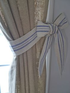 DIY::  Bow Curtain Tie Backs using ticking....yuck that material...BOW tie back would be perfect in babies minnie mouse room though <3
