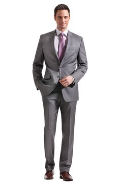 Calvin Klein, 100% Wool, side vent, two-button jacket and flat front pant, Suit Separate in grey. Calvin Klein, micro stripe dress shirt in light grey. Calvin Klein, diagonal striped tie in navy, grey and white.