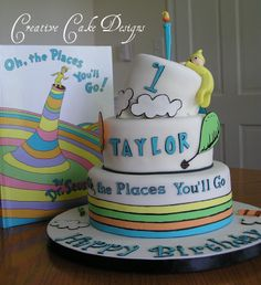 Dr Seuss Birthday Cake - I was asked to make a cake to match this book. Two musts were; the tilted top and the little guy holding onto the side. She left the rest to me. =)