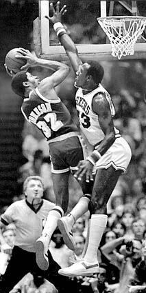 Earvin Johnson with no place to go against Darryl Dawkins
