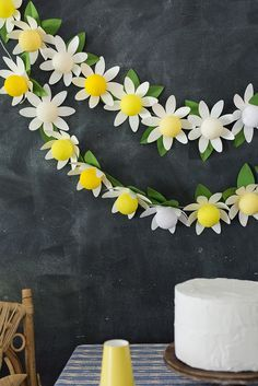 DIY paper daisy string lights by The House That Lars Built using Bright Lab Lights (Diy Paper House) Diy Hanging Shelves, Diy Wall Shelves, Paper Daisy, Paper Flowers, Daisy Party, Do It Yourself Inspiration, Idee Diy, Glow Sticks, How To Make Paper