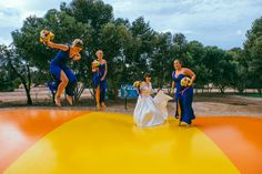Fun wedding photos! Bright Royal Blue and Yellow themed vintage wedding. Long sleeved lace wedding dress. Long royal blue bridesmaid dresses. Bright flower bouquets. Wedding dog wore a yellow and blue bow tie. Calvin Klein shirt. Marc Jacobs ties. Winery photo shoot. Photos also done in the Maxwell Winery maze. Photography by Jay Wennington. DIY decorations, including paper pinwheels, kraft paper table runner and rosette backdrop. Budget wedding. Hopefully our wedding will give other people…
