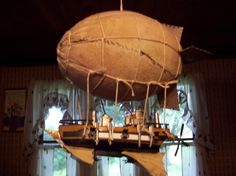 Steampunk Airship made out of model ship and plane parts and a nerf football.