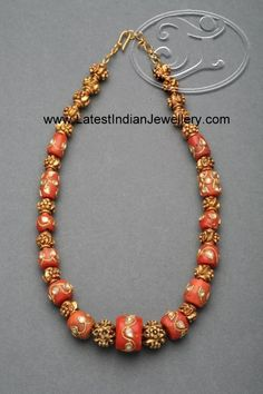 Intricate Gold Work on the Corals Studded with Kundans enhances the look - Latest Indian Jewellery Designs Bijoux Design, Gold Jewellery Design, Bead Jewellery, Schmuck Design, Beaded Jewelry, Beaded Necklace, Jewellery Shops, Jewellery Holder, Silver Jewellery