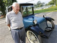 Modern electric cars look to the past; basic ideas behind battery-powered vehicles not new in #Toledo PHOTO: Ford Cauffiel, a Toledo entrepreneur and noted car collector, has owned his Toledo-built 1917 Milburn Light Electric for more than a decade. THE BLADE/ANDY MORRISON