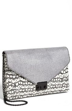 $395, White and Black Leopard Clutch: Loeffler Randall Lock Clutch Blackwhite Mix. Sold by Nordstrom. Click for more info: https://lookastic.com/women/shop_items/60398/redirect