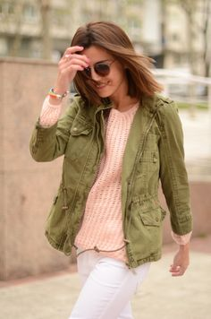 Early Spring White jeans, pink sweater, and green adventure jacket.