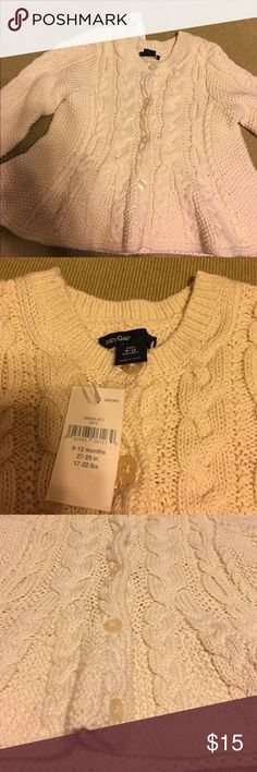 New Baby Gap Sweater Cream cable knit peplum sweater. 6-12 months. New with tags! Perfect for any little doll's wardrobe! Currently on sale on the website for $26, originally $35. GAP Shirts & Tops Sweaters