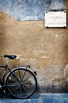 She decided to sit on the curb and wait and see if the owner of the bike just might be her future husband.  She had read 'Il postino' and knew such things were possible.  After all, she was a romantic through and through.