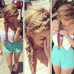 I have no idea what she's wearing but the hair is really pretty :)