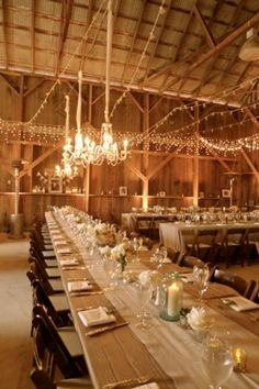 Love the idea of having the tables lined up to be one long table. barn reception table decor
