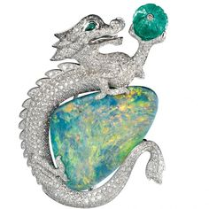 Brooch in platinum with opal, emerald, emerald eyes and diamonds by Cartier