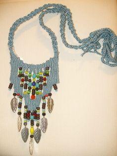 Anastasia Iordanaki-necklace: cotton, glass and wood beads,metal parts