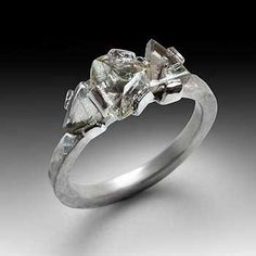 Todd Pownell: , Platinum ring with three uncut triangular diamond crystals (2.20TCW). 2mm wide hammered shank, size 6.5 (May be sized to fit)