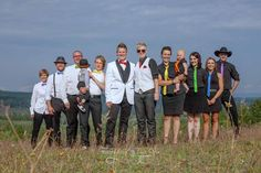This rainbow coloured wedding party poses for an outdoor formal picture. Wedding photography by Throughout Time Photography, #Quesnel, #British Columbia, #rainbow colour theme, #lesbian wedding, girls, #farm, #field, #sunny, #bright, posing, #ranch, #white, #black, #bright sunshine,  standing, #summer, #summer wedding, #gay marriage, #gay wedding inspiration, #gay wedding photography ideas
