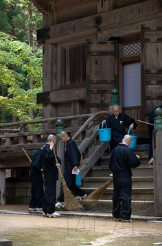 Japan - Shingon Sect monks tidy up a temple building on Mount Koya - Photo by Photo Japan