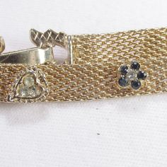 Vintage 1960's gold toned mesh hearts and flowers by jewelry715, $10.00