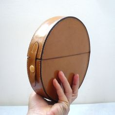 BABYBEL French Vintage 60s Round Leather Clutch - via Etsy.