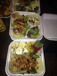 Grilled Chicken Salads with ;cheese,bacon,croutons ,egg,onion,candied walnuts and cranberries with a side of pineapple slices fresh strawberry & seedless grapes